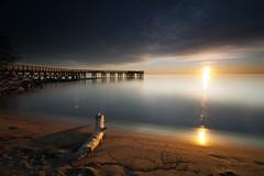 a little sun flare (dK.i photography (1.3 mil and still banned)) Tags: longexposure light sun shells beach sunrise