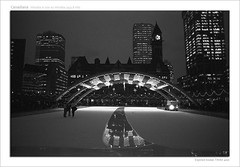 Canadiana (d[^.-]b..oO(MJWong)) Tags: winter blackandwhite toronto ontario canada reflection film ice water night photoshop lights downtown minolta kodak outdoor tmax cityhall skating d76 frame rink epson expired caption 400asa zamboni x700 v700 nathanphilipsquare minoltamd50mmf17 roll0006 minoltamd24mmf28