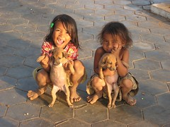 Two naughty sisters playing with puppies (Kep, Cambodia 2012)