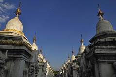 Stupas of the Kuthodaw Pagoda in Mandalay_HXT2634 (ohmytrip) Tags: morning sky cloud white horizontal architecture sunrise outdoors pagoda stupa religion nopeople repetition myanmar spirituality narrow mandalay inarow placeofworship colorimage famousplace pedestrianwalkway buildingexterior nationallandmark kuthodawpagoda builtstructure