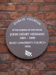 Photo of John Henry Newman brown plaque