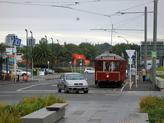 Wynyard Loop Tram (russelljsmith) Tags: road birthday family blue trees red newzealand sky orange cloud brown bus green cars nature car electric buildings grey waterfront harbour tram entertainment auckland nz runs 2012 waitemataharbour 77285mm wynyardquarter wynyardloop