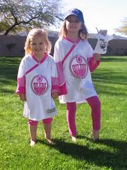 Sisters in their new Edmonton Oilers jerseys (Beauty Playin 'Eh) Tags: sisters barbiedoll smilinggirls edmontonoilers nhlhockey pinkoilers