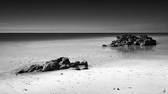 Platja (nancian) Tags: sea black praia beach portugal mar blackwhite rocks playa nd algarve rocas platja roques neutraldensity praiadamarinha densidadneutra