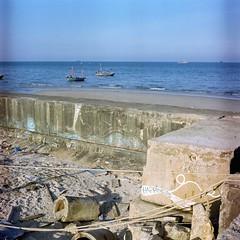 Happiness (lonely radio) Tags: 6x6 film water mediumformat thailand boats sand shadows happiness ropes huahin yashicamat124g 000018 kodakektacolor160 yashinon80mmf35