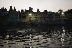 Jain Ghat and the styrofoam boat (zacdavies) Tags: sunset india river boat dusk swastika varanasi styrofoam jain ganga ganges ghat