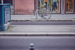Early Morning Bike (Kaan Turan) Tags: road cold color reflection colors bike bicycle train warm purple overcast sidewalk trainstation ubahn fujifilm 56mm xt1 fujix xf56mm