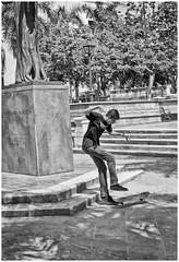 Beneficencia Plaza (Samy Collazo) Tags: canon kodak oldsanjuan puertorico streetphotography sanjuan viejosanjuan lightroom kodaktrix400 kodakd76 fotografiacallejera lightroom3 epsonperfectionv500scanner niksilverefexpro2 beneficenciaplaza industar2250cmf35 canonlld2i955leicacopy