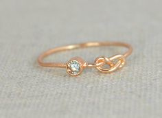 Aquamarine Infinity (alaridesign) Tags: white rose by gold march infinity band aquamarine knot ring mothers filled rings birthstone stackable alaridesign