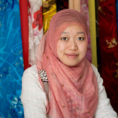 Saleslady (kevinschoenmakers) Tags: china pink woman color colour girl smile lady square asian religious asia muslim islam religion headscarf central chinese hijab east muslims lanzhou centralasia province islamic gansu eastasia