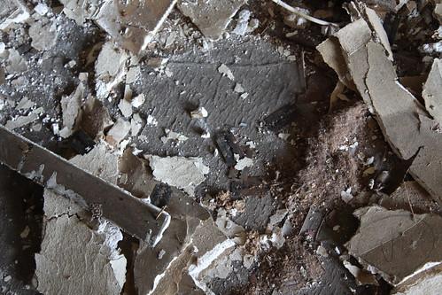 Rusty razor blades in debris pile