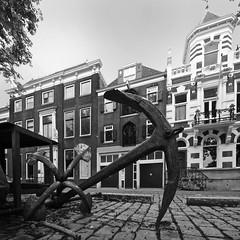 down low in dordrecht (Cybergabi) Tags: bw square harbor cobblestones dordrecht anchor lowangle 10mm