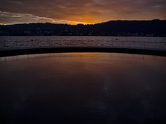 Badi Tiefenbrunnen (doors_of_perception) Tags: winter sunset wasser sonnenuntergang zurich wolken zrich sonne wellen badi tiefenbrunnen