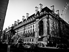 Building~ (Halibel14) Tags: street camera city greatbritain light shadow england blackandwhite bw building london monochrome car digital pen dark island photography photo streetphotography olympus palace adobe thebeatles ferriswheels lightroom 1442mm epl1 mzuiko