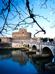 Castel S. Angelo Bridge (Claudio Cantonetti) Tags: old city travel bridge blue sky urban italy sculpture white vatican rome roma reflection building tree tower castle art history classic tourism monument water saint statue stone wall architecture angel night river landscape wings italian ancient europe italia european cityscape arch view cross roman antique basilica famous religion sightseeing culture landmark center tourist panoramic medieval historic ponte vaticano mausoleum tiber tevere empire marble angelo fortification fortress bernini sant archangel hadrian castel attraction monumental