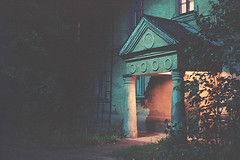 Old porch (Andrey Timofeev) Tags: street old trees light film architecture night 35mm branches porch column ussr        35   asahipentaxk1000 kodakektar100  autumn2010