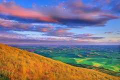 Digging Life (Ireena Eleonora Worthy) Tags: sunset sky mountains green clouds washington spring colours wind farmland hills wa palouse steptoebutte colorphotoaward northernstraitsphotography