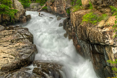 Blurred Stream Rushing through Granite Rocks on the Beartooth Highway in Custer National Forest - Wyoming (Carl's Photography) Tags: summer tree green rock vertical landscape iso100 waterfall nationalpark nikon outdoor tripod bracket processing yellowstone gps hdr scenics wy tranquilscene bracketing 4x6 beartoothhighway custernationalforest beautyinnature f29 photomatixpro 18200mmf3556gvr 14sec d7000 nikond7000 hdrcandidates gettyartistpicks zenfolioimage 2011blackhillsyellowstonebeartoothhighway320ranchtetons 14secatf29 gettyimages2012
