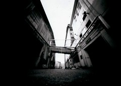 Abandoned (Salt.as) Tags: camera city sky blackandwhite bw white black abandoned 30 buildings paper diy scary long exposure industrial factory cityscape wide perspective large pinhole greece negative homemade area scanned second 4x5 format 19 ilford largeformat obscura patras patra nolens overdeveloped multigrade mgiv 03mm ladopoulos vightening ladopoulou