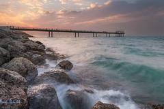 Sunset over Soug Sharg Pier! - Kuwait (AlkhashabNawaf) Tags: sunset sea seascape beach landscape pier rocks fuji kuwait nawaf soug غروب sharg شاطئ سوق بحر xe1 صخر شرق اسكلة alkhashab