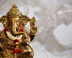 Elephant God (Bhaskar Dutta) Tags: wallpaper india texture metal ganesha worship god bokeh indian garland card ganesh idol hindu brass mythology vinayaka ganapati elephand pillaiyar