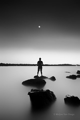 Moon Silhouette [Explored] (Meljoe San Diego) Tags: bw moon seascape nikon rocks explore sihouette d300 gnd 1024mm meljoesandiego
