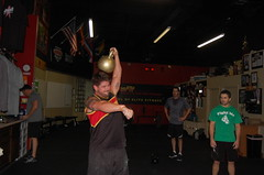 Chris shows his strenght and power with a 97 lb Kettlebell at CrossFit Scottsdale (SICFIT Scottsdale) Tags: team power grow elite benefit strength scottsdale athletes build athlete fitness endurance relationships encourage physical results succeed physicalfitness crossfit achieve elitefitness bestresults crossfitscottsdale fitnesslevel buildrelationships