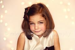(Rebecca812) Tags: christmas family portrait brown cute girl beauty smile studio festive child sweet innocent daughter tan newyear hazeleyes taffeta brownhair hairbow christmaslightbokeh canon5dmarkii rebecca812 heritage2011