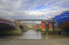 Blackfriars Bridge and Blackfriars Railway Bridge from Southbank (yorkshire stacked) Tags: winter sky london thames clouds river boats workers construction nikon scaffolding colours bridges southbank cranes scaffold lowtide renovation riverthames hdr railwaybridge blackfriarsbridge bracketing blackfriarsrailwaybridge photomatix bracketed december2011 nikkor18105mm nikond7000