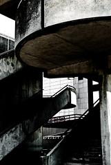 Desolate And Disused - Parc De La Villette, Paris (Janicskovsky) Tags: park old paris france building slr architecture french spiral concrete nikon university swiss culture gritty science tourists dirty architect staircase worn weathered dslr deconstruction patina francais activities parcdelavillette selectivecolor studytrip selectivecolour citdessciencesetdelindustrie deconstructivist colourselection bernardtschumi d80 nikond80