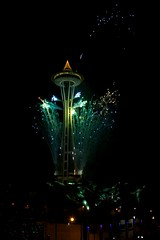 Aquamarine Needle (Slideless in Seattle) Tags: seattle colors reflections lights bright fireworks nye newyear spaceneedle newyears experiencemusicproject streaks emp seattlecenter 2012 canonef24105mmf4lis