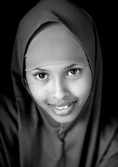 Portrait Of Beautiful Young Woman Wearing Veil In Berbera Somaliland (Eric Lafforgue) Tags: africa portrait beauty smile face vertical outdoors exterior african hijab afrika somali somalia somaliland afrique hornofafrica highangle berbera onepersononly somalie africanethnicity blackwhiteblackandwhite britishsomaliland somali 4227 photographphoto   szomlia   blackethnicity soomaaliland  berberabarbara veilmuslimislamislamic