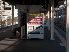 I stand alone without beliefs (kasa51) Tags: light shadow station japan digital lumix platform panasonic vendingmachine yokohama f18 olympuspen 45mm     gf1  mzuiko 11