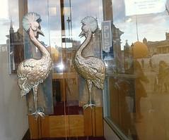 Uganda House (helenoftheways) Tags: uk sculpture london freeassociation birds reflections doors trafalgarsquare glassdoors ugandahouse crestedcranes detalhesemferro trafalgarsun
