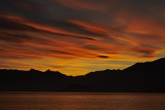 ...and fire in the sky (scozzola) Tags: sunset lake dark landscape nikon ngc explore bellagio 1001nights comolake lagodicomo autofocus cotcmostinteresting 1001nightsmagiccity flickrawardgallery ringexcellence blinkagain dblringexcellence d3100 bestofblinkwinners blinksuperstars scozzola