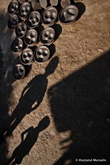 Symphony of Clay X (Sopnochora) Tags: life shadow smile work canon circle eos day pattern hand with potter peoples story clay pottery ttl kr bp shape bangladesh 1022mm circular 500d art people village flickr canon light people best hand print day village image photographers clay potter potter clay bangladesh circle bangladeshi pattern 500d sopnochora