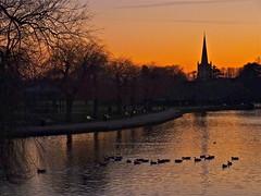 Avon Sunset (Deepgreen2009) Tags: winter sky orange cold ice church water sunshine birds silhouette river golden frost spire avon stratforduponavon