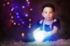 Young Fortune Teller (Marcio.Ricardo.Fernandes) Tags: portrait baby girl infant funny glow child bokeh campogrande gipsy crystalball