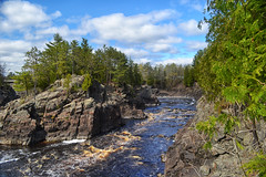 Jay Cooke State Park (Liz Nemmers) Tags: road bridge cliff sun nature water clouds river landscape photography nikon rocks north mn northwoods jaycookestatepark northernminnesota jaycooke carltoncounty nikond3100