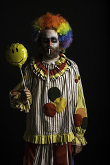 Here to have a good time. (legaryphotography) Tags: shadow portrait dark studio happy photography 50mm photo costume nikon moody sad mask cigarette clown balloon masks photograph wig portraiture angry depressed mad clowns emotions twisted