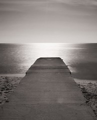 beyond the horizon of the place we lived when we were young (Tiziano De Donno) Tags: bridge sea sun nd gallipoli salento density lunga esposizione neutral
