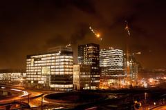 Deus Ex (think4d) Tags: oslo night lights hotel crane roundabout citylights constructionsite nighttraffic longtimeexposure deusex wetstreets glowingclouds modernbuildings futurecity bureauoffice