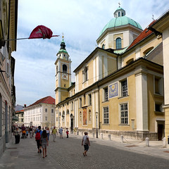 Saint Nicholas Cathedral of Ljubljana stands above the city (Bn) Tags: street old city trip summer people holiday streets men green castle history church saint river walking square geotagged town hall topf50 women energy europe child cross cathedral market andrea small hill capital sightseeing central relaxing scenic atmosphere pedestrian down charm tourist chapels nicholas architect slovenia dome latin shops ljubljana local baroque wandering beloved pozzo laibach strolling ljubljanica lubiana methodius 50faves stolnica joe nikolaja svetega plenikits geo:lon=14508911 geo:lat=46050646