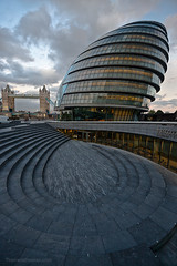 Two Monuments with curvy stairs in one frame! (www.thameralhassan.com Thamer Al-Hassan) Tags: street uk travel bridge windows sunset england building london tower tourism monument glass architecture modern clouds stairs composition towerbridge canon photography grey photo photographer image britain cityhall contemporary fineart curves great picture wideangle best architect stunning council fullframe curve modernarchitecture thescoop lean  alhassan thamer canonef1635mm 5dmarkii 5dmkii 5dmark2  thameralhassan contemporaryarchitect