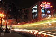 Go By Streetcar (Ian Sane) Tags: street light max car by night oregon portland ian photography long exposure downtown time district go trails images line starbucks intersection pearl 11th curve streetcar avenue lovejoy sane