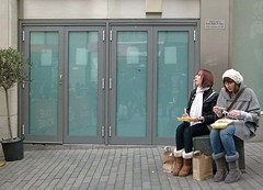 Duty now for the future (Andy WXx2009) Tags: girls england urban woman glass fashion bench lunch birmingham europe sitting legs boots eating candid femme fastfood hats streetphotography jeans doorway bags scarfe mygearandme