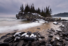 Hovland Rock III (Bryan Hansel) Tags: usa cold ice stone clouds dark island waves shoreline stormy mn lakesuperior hovland