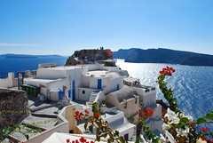 Oia Castle (Jeka World Photography) Tags: world travel flowers blue red sea vacation white holiday castle jeff rose architecture stairs greek photography volcano nikon europe paradise mediterranean niceshot aegean santorini greece caldera villas oia thira redflowers jeka d60 jeffrose jekaworldphotography jeffrosephotography kalitharosephotography