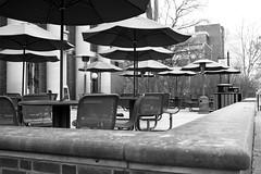 Deserted (derekbruff) Tags: bw cafe empty tables umbrellas