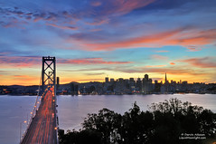 Goodbye 2011, a Sunset to Remember - San Francisco California (Darvin Atkeson) Tags: sunset sanfrancisco baybridge skyline newyearseve 2011 newyears twilight dusk nightfall cityscape landscape newyearseve2012 citybythebay suspension bridge embarcadero fireworks show darv darvin lynneal atkeson liquidmoonlightcom 4th july